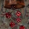 Six dice fall from a beaker / Sechs Würfel fallen aus einem Becher