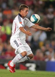 Lukas Podolski von Bayern München bei einem Spiel gegen den FC Barcelona