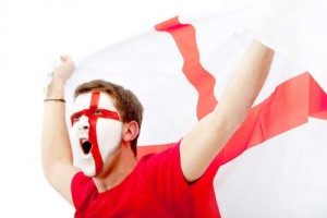 Man with the English flag painted on his face / Mann englischer Flagge auf seinem Gesicht gemalt