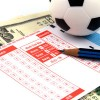 Football Betting Slip with US Dollars / Fußball-Wettschein und US-Dollar-Noten