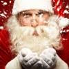Santa Claus blowing snow from his hands / Weihnachtsmann bläst Schnee von seinen Händen