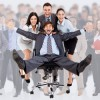 Excited business people group push team leader in chair / Begeistertes Team mit Teamleiter im Bürostuhl